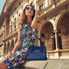 Women Posing With View Of The Navy Blue Leather Handbag With Shoulder Strap