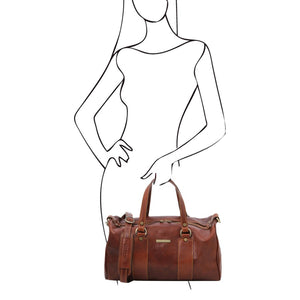 Women Posing With The Brown Leather Ladies Duffle Bag