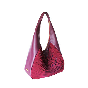 Angled View Of The Burgundy Ladies Leather Shoulder Bag