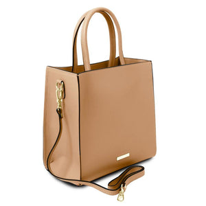 Angle View Of The Champagne Vertical Leather Tote