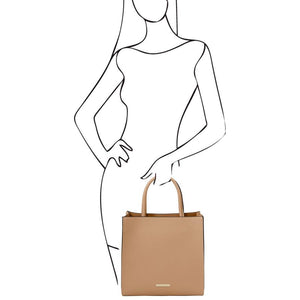 Woman Posing With The Champagne Vertical Leather Tote