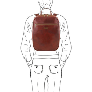 Man Posing With The Brown Leather Laptop Backpack