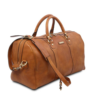 Angled View Of The Natural Leather Travel Duffel Bag