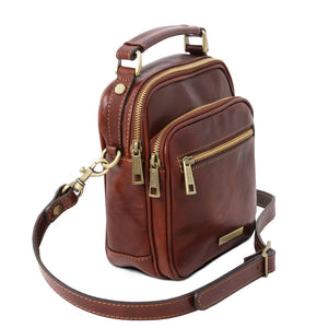 Angled And Shoulder Strap View Of The Brown Crossbody Bag Leather