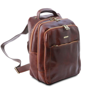 Angled And Front Zip Pockets View Of The Brown Mens Leather Laptop Backpack