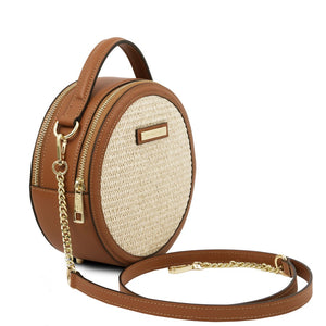 Angled And Shoulder Strap View Of The Cognac Round Handbag