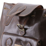 Top Angled Accented Buckle View Of The Dark Brown Leather Backpack For Travel