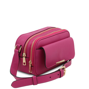 Angled View Of The Fuchsia Small Leather Camera Bag