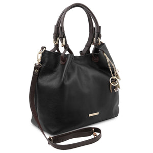 Angled And Shoulder Strap View Of The Black Soft Leather Shopper