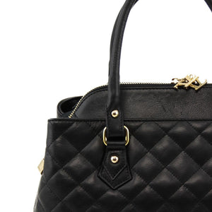 Close Of Leather Handles View Of The Black Quilted Leather Handbag
