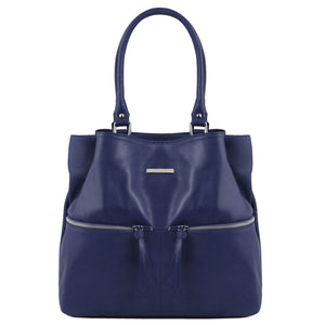 Front View Of The Dark Blue Leather Shoulder Bag With Outside Pockets