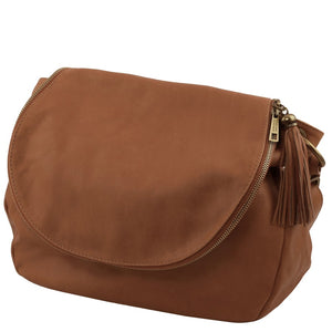 Angled View Of The Cinnamon Tassel Crossbody Bag