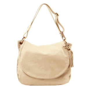 Front View Of The Beige Tassel Crossbody Bag