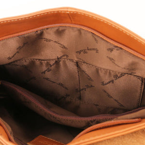 Internal Features View Of The Cognac Tassel Crossbody Bag