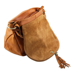 Opening Flap View Of The Cognac Tassel Crossbody Bag