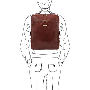 Man Posing With The Brown Leather Backpack Laptop Bag