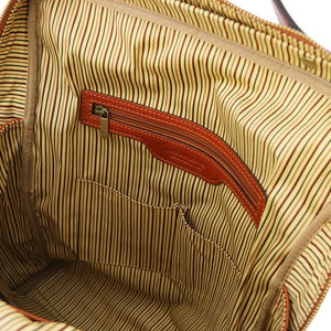 Internal Zipper Pocket View Of The Honey Leather Backpack Laptop Bag