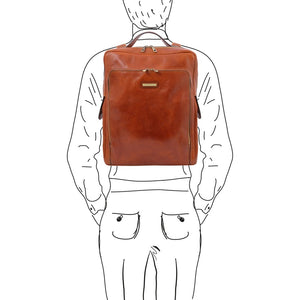 Man Posing With The Honey Leather Backpack Laptop Bag