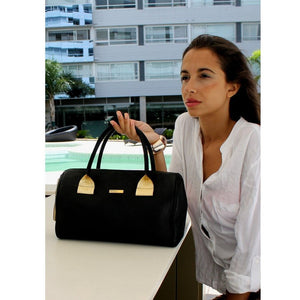 Women Posing With The Black Womens Leather Duffel Bag