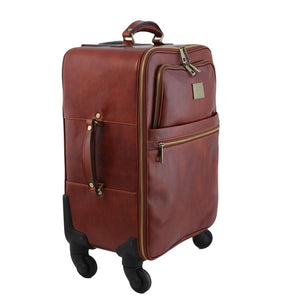Angled View Of The Brown 4 Wheeled Luggage