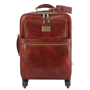 Front View Of The Brown 4 Wheeled Luggage