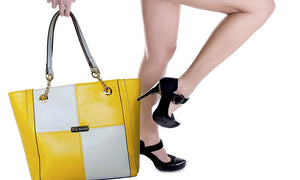Women Posing With The Yellow And Cream Blocked Kylie Leather Handbag-On Sale
