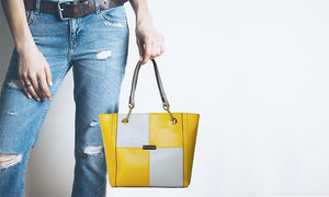 Women Holding The Yellow And Cream Blocked Kylie Leather Handbag-On Sale