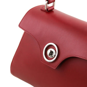 Angled Shot Of The Opening And Closing Twist Lock Of The Red Womens Duffle Bag