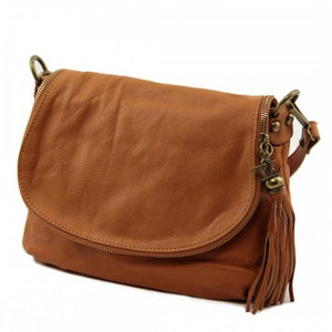 Left Angled View Of The Cognac Leather Tassel Bag