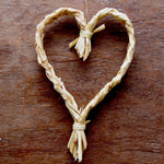 Medium Pueblo Heart is 9x6 inches (height x width) with a natural grain tie.