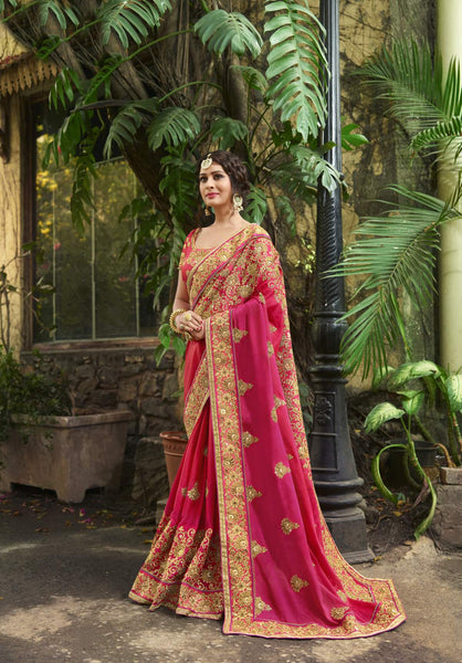 This Pretty Saree In Dark Pink Color Paired With Dark Pink Colored Blouse