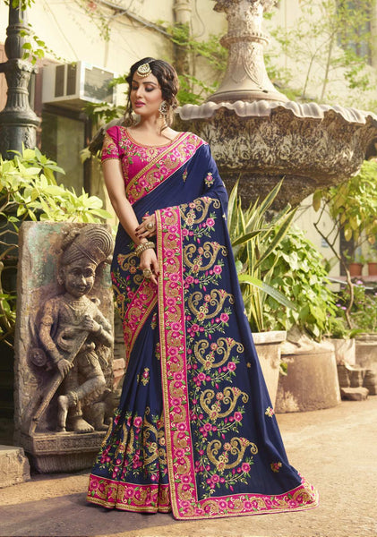 This Designer Saree In Navy Blue Color Paired With Contrasting Dark Pink Colored Blouse