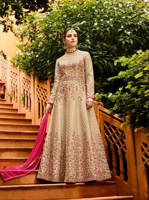 Simple And Elegant Looking Designer Floor Length Suit Is Here In Beige Color Paired With Dark Pink Colored Dupatta