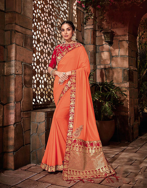 The saffron-red color Georgette & Brocade Designer Saree with Unstitched Blouse