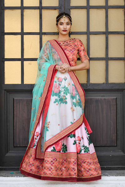 This Designer Lehenga Choli In Orange Colored Blouse Paired With Light Pink Colored Lehenga