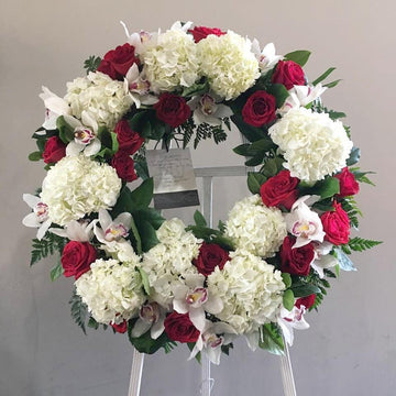 Red + White Wreath on Easel