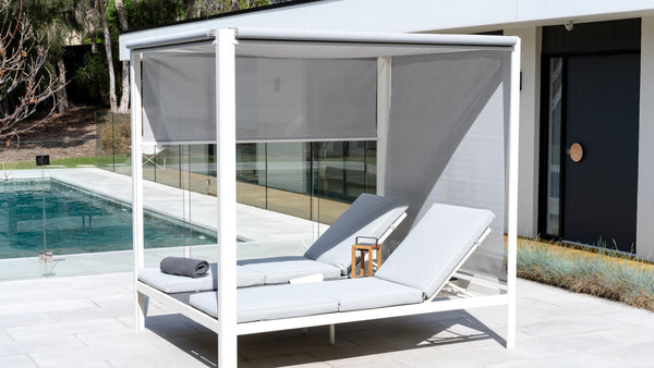 Nothing Says Poolside Tranquility Like a Four Poster Daybed