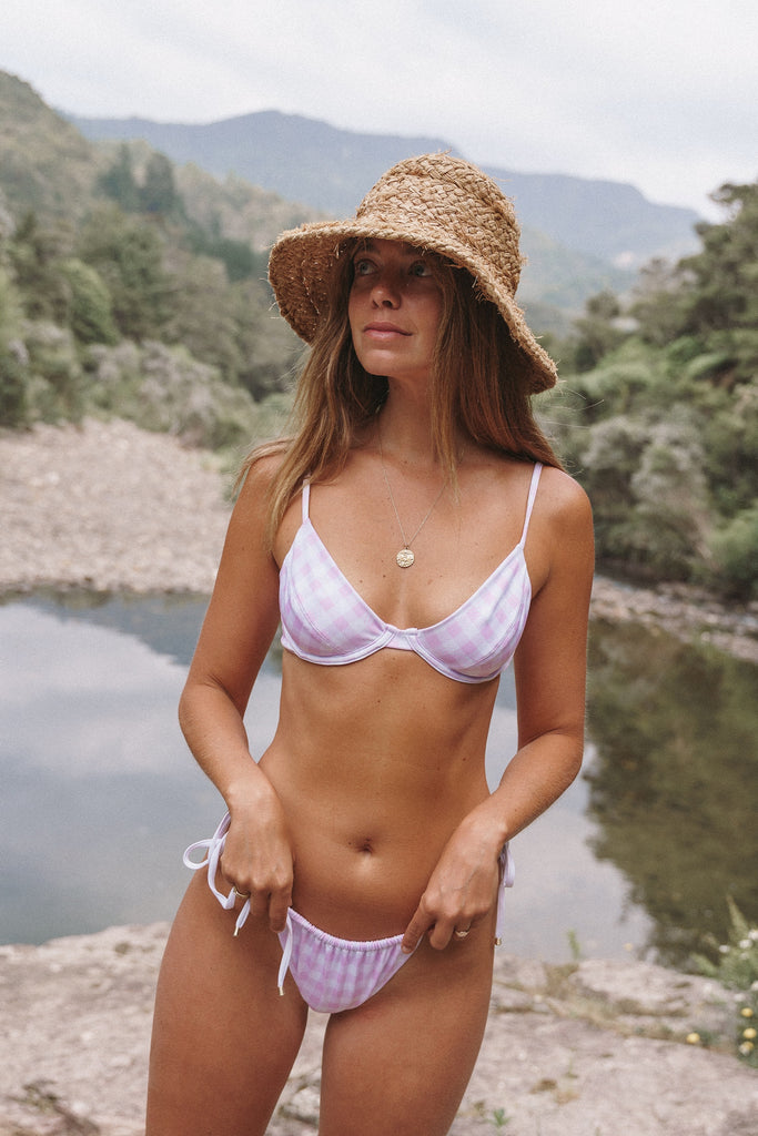 New Zealand landscape, Christina Macpherson wears the Sydney underwire bra top and Miami drawstring bottoms in pink check