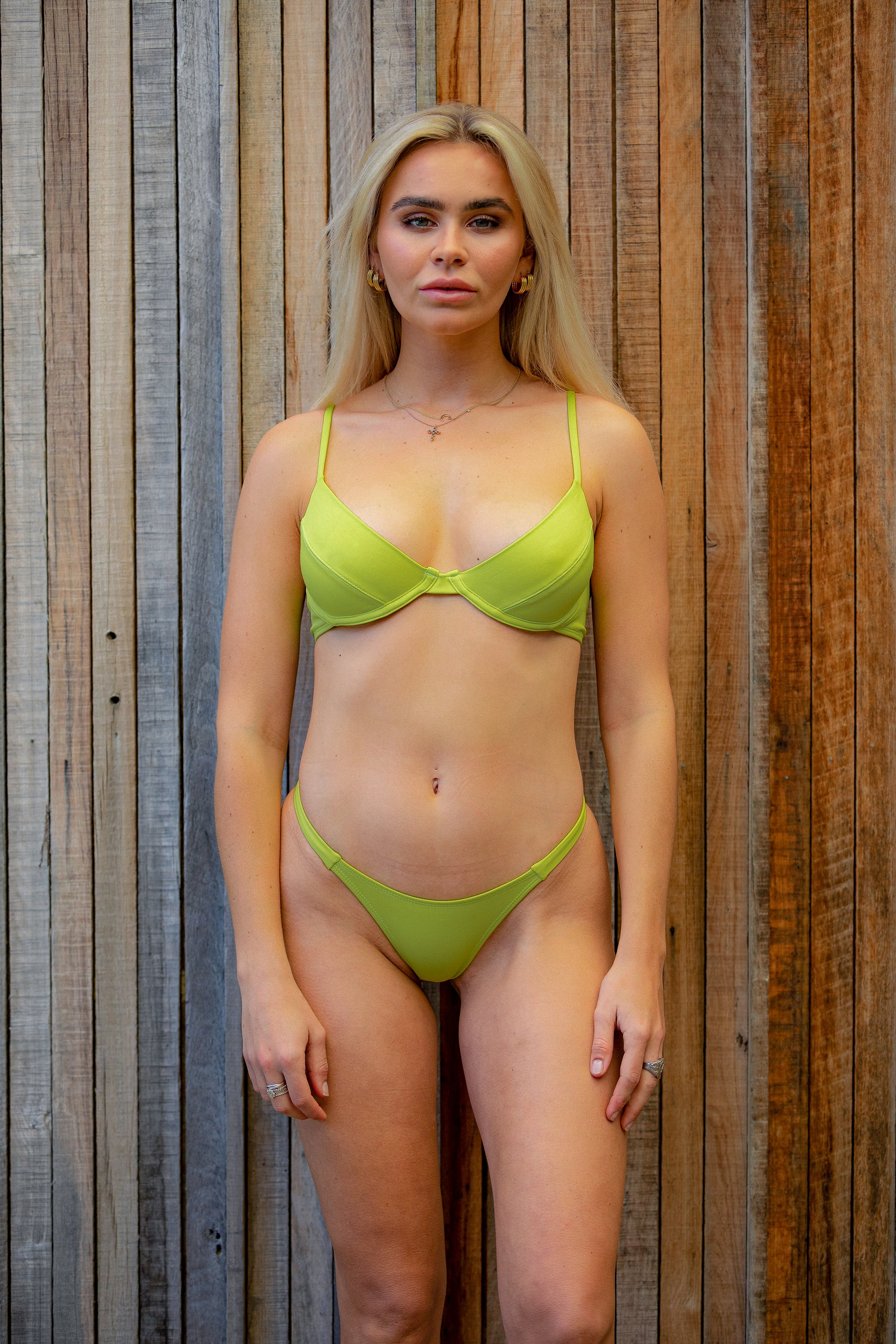 Zingy lime bra bikini top, featuring adjustable straps and underwire support. Made using sustainable and eco-friendly fabric - Amni Soul Eco®. Luxury swimwear for a better world, with better tan lines.