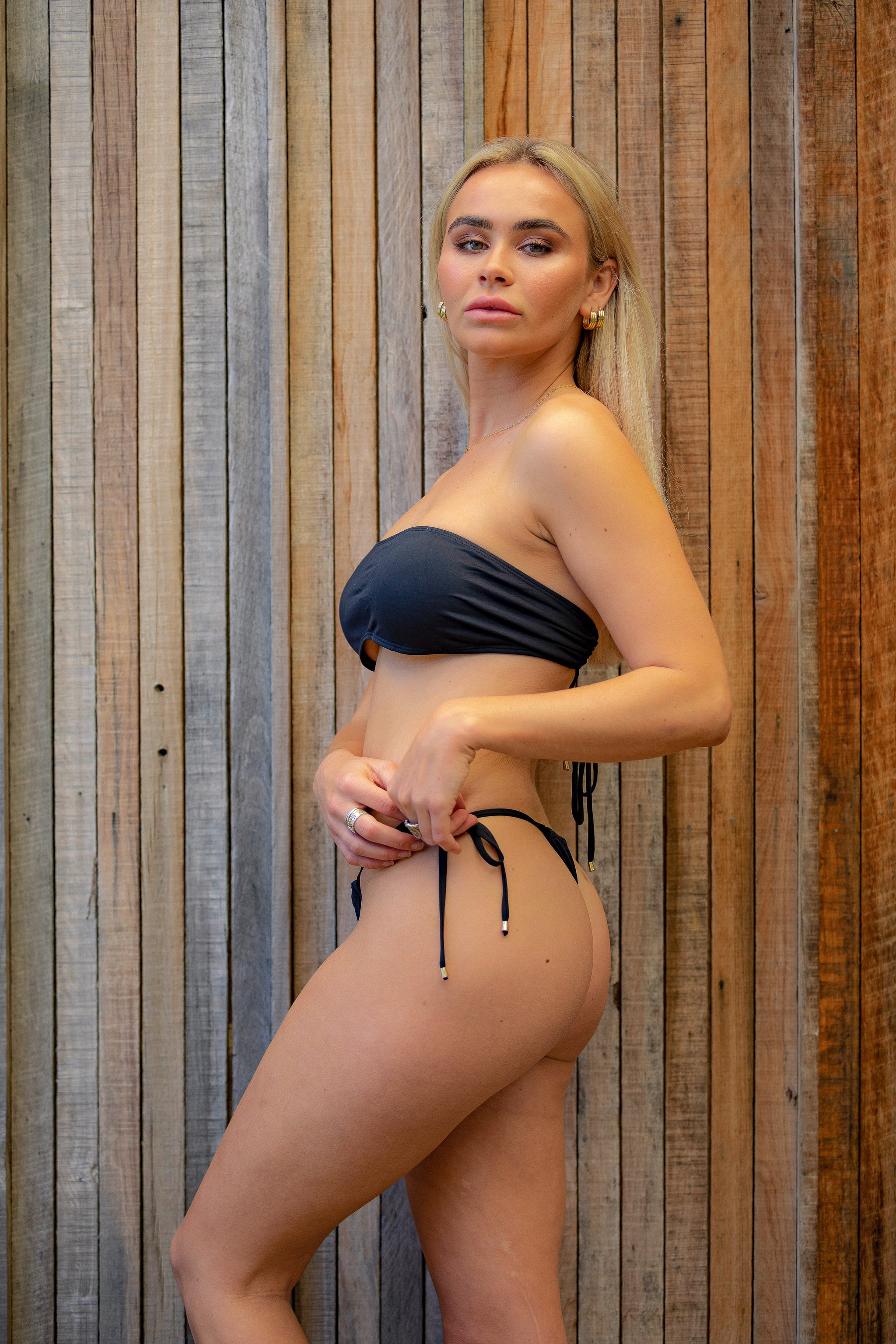Black drawstring bikini bottoms with gold toggles. Made using sustainable and eco-friendly fabric - Amni Soul Eco®.