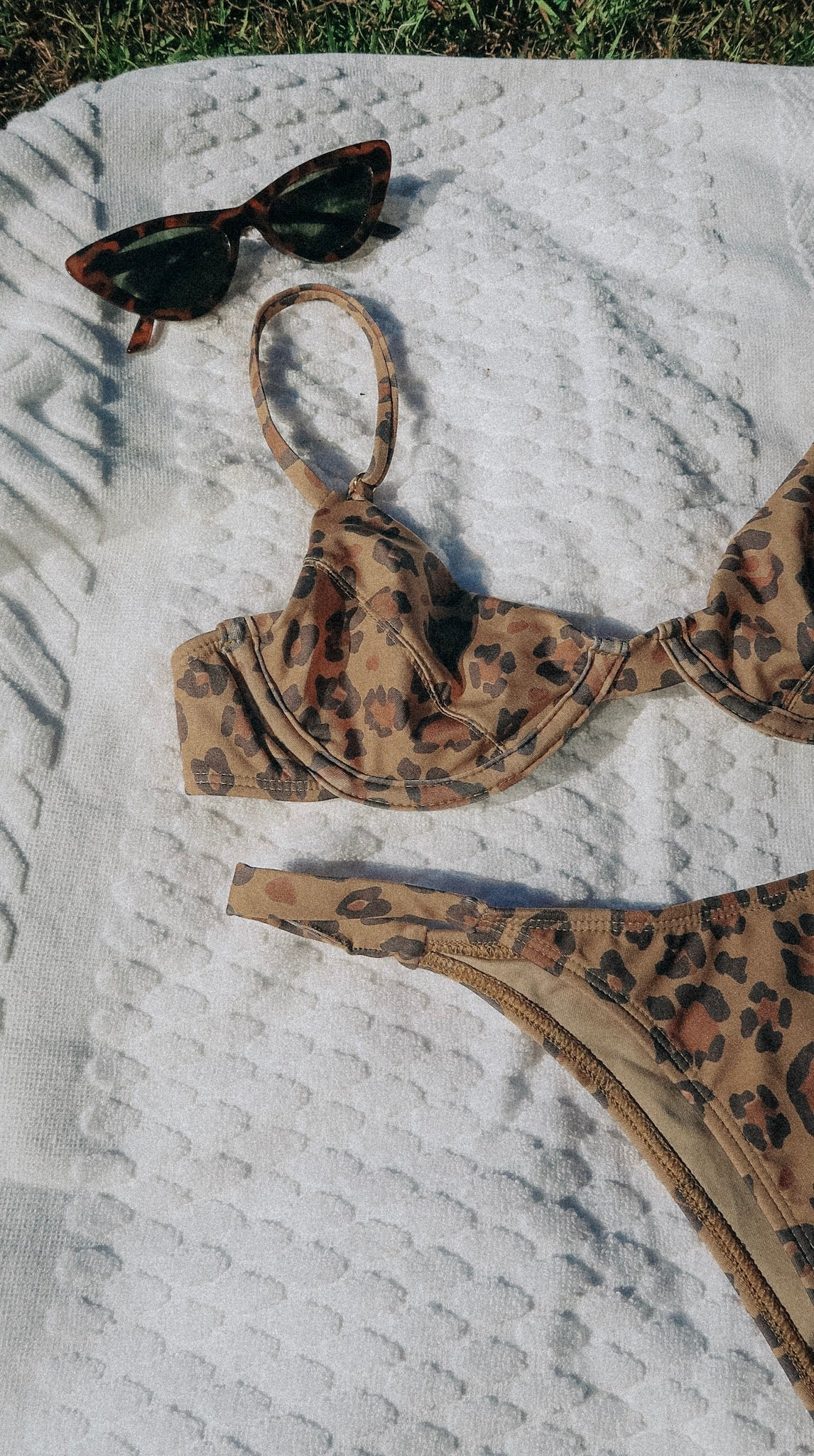 Leopard print bikini bottoms, featuring an 80's style high leg and brazilian cut on the booty. Luxury swimwear for a better world, with better tan lines.