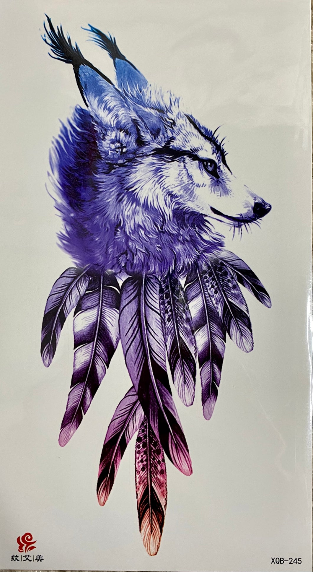 Wolf Head with Feathers Tattoo