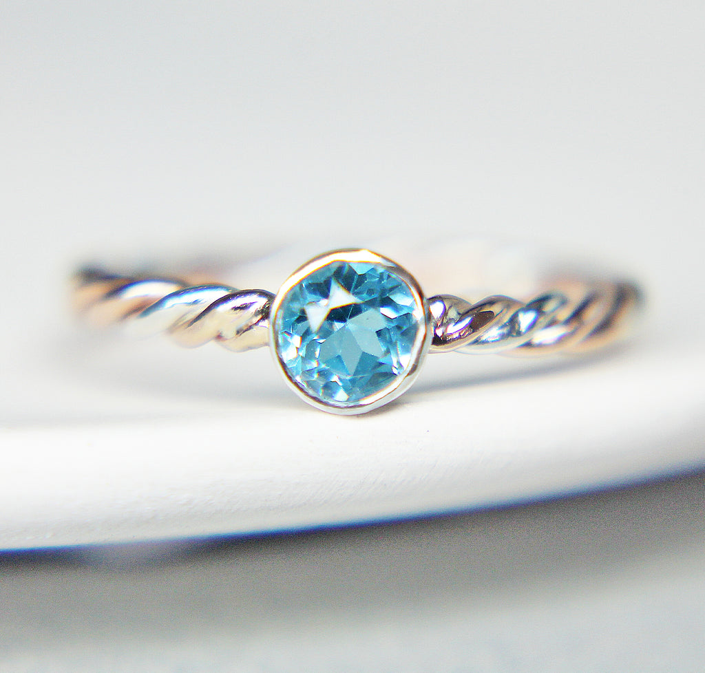 14K Blue Topaz Twist Solitaire
