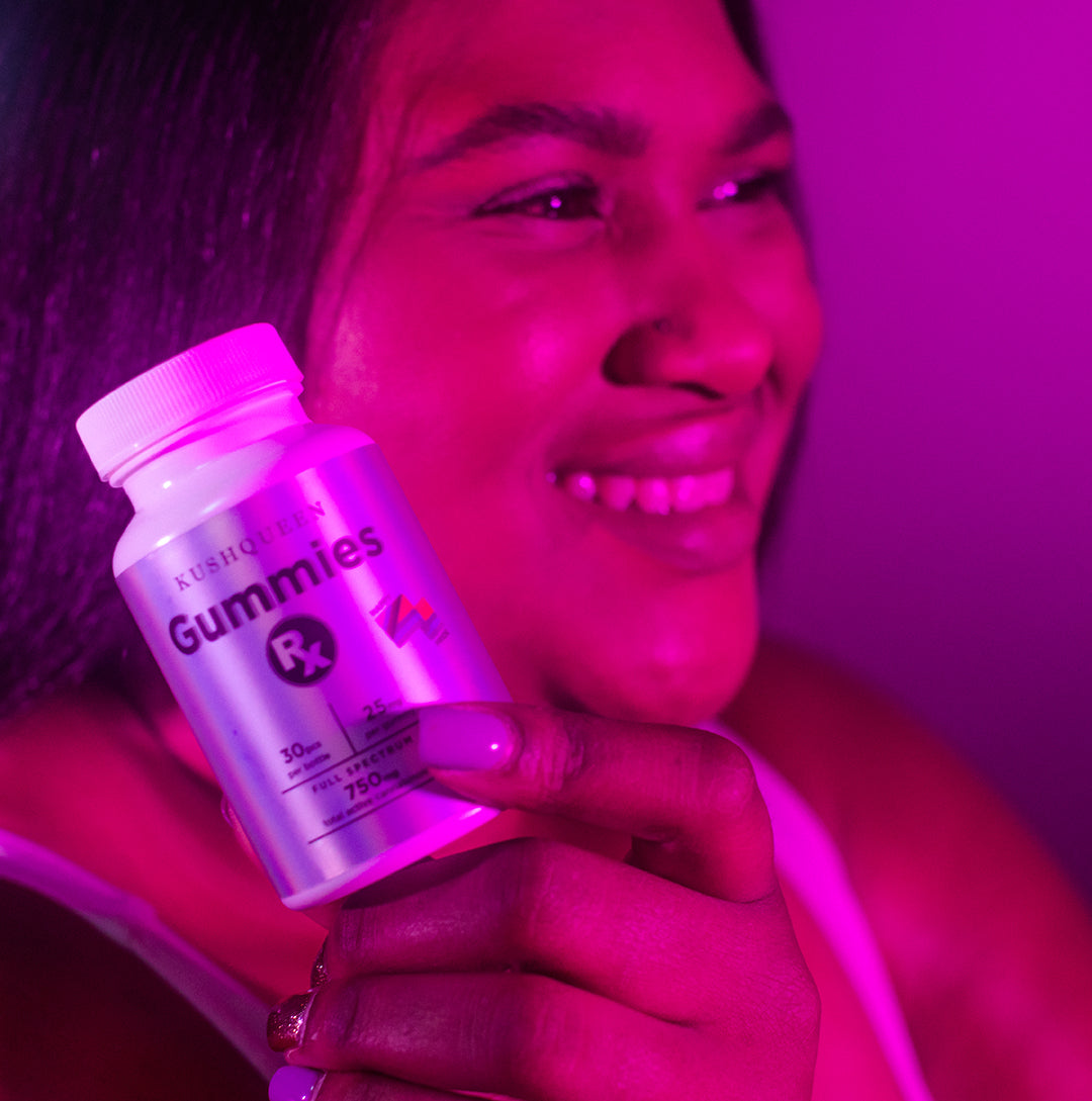 Gummies Rx Full Spec 750mg being held by a beautiful model in purple light.