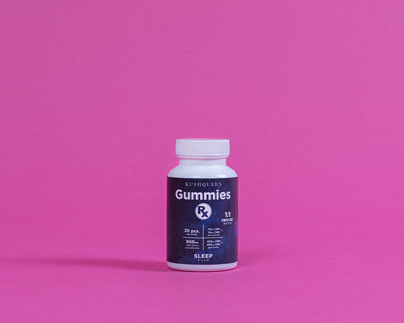 Kush Queen's CBD Gummies Rx Sleep shown in its dark blue bottle against a pink background.