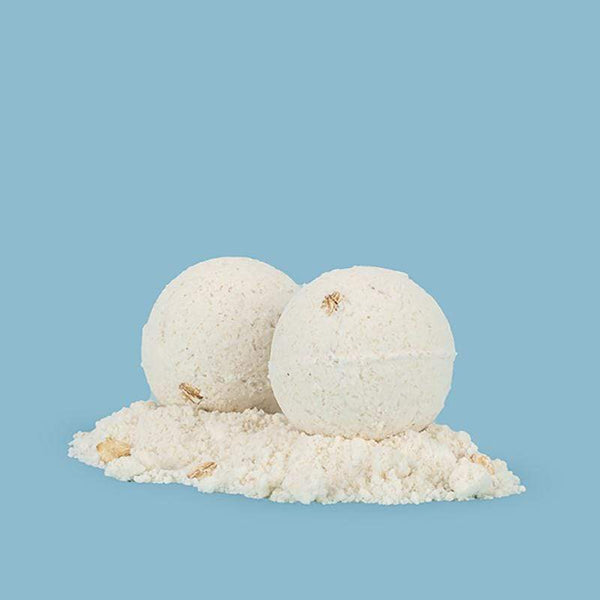Woof Queen Lavender CBD Bath Bomb shown with no packaging. Each Woof Queen order comes with two small CBD Bath Bombs.
