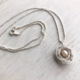 Birds nest silver and pearl mother's necklace