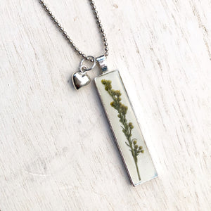 Pressed flowers in resin silver bar pendant with heart