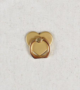 lmnt-gold-heart-phone-ringstand-web1.jpg
