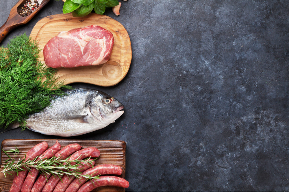 Meat and seafood on a countertop - important sources of fat and protein on the keto diet